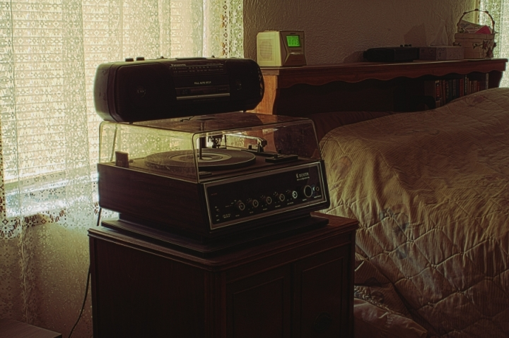 Bedroom with outdated music players